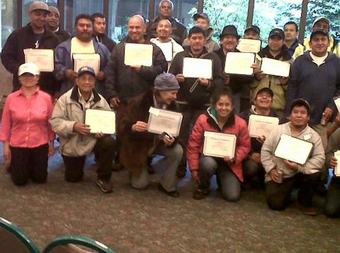 class posing with certificates