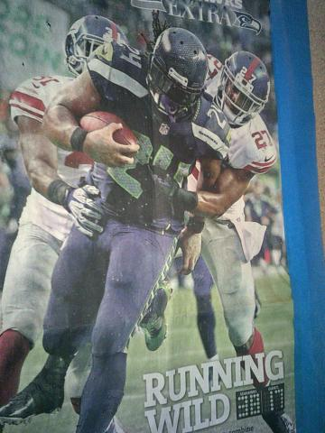 newspaper with Seahawk photo