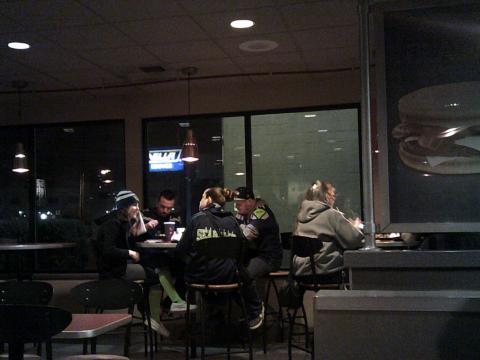people wearing Seahawks jerseys in a bar