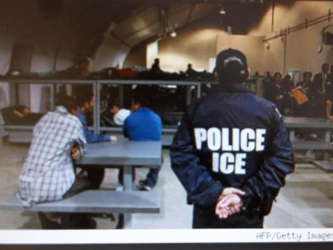immigration police officer overseeing undocumented immigrants
