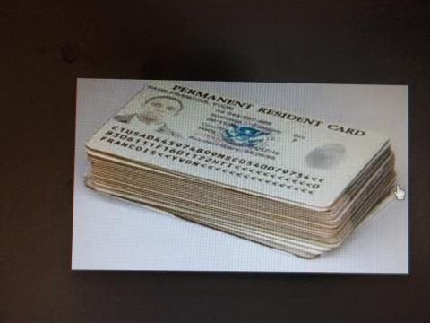 stack of permanent residency cards