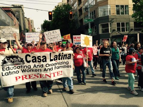 marchers with Casa Latina sign
