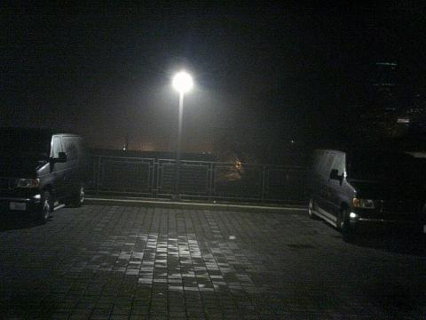 two vans parked in a dark parking lot