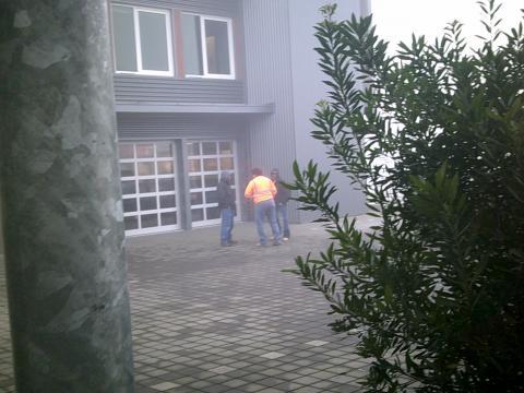 three men standing in fog outside Casa Latina
