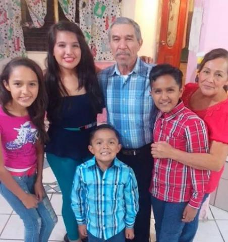 Maria, her brother, sister-in-law, and three children