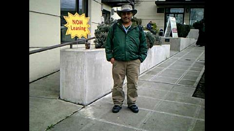 man standing on sidewalk