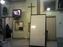 cross on wall of meeting room