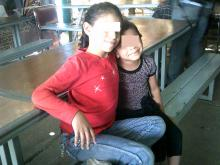 Photo of two girls sitting