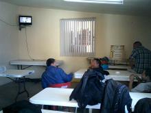 people indoors watching tv