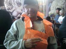 man wearing orange vest