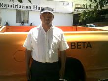 Photo of man in front of orange truck
