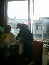 men in chairs at Casa Latina