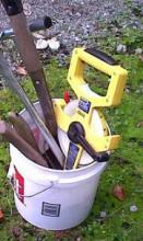 gardening tools in a bucket