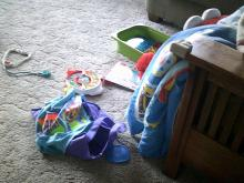 child's toys on carpet