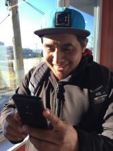photo of Pedro with his phone