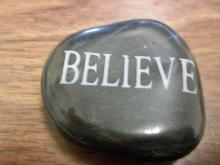 "Rock with ""believe"" engraved into it"