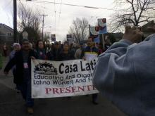 Demonstrators with Casa Latina sign