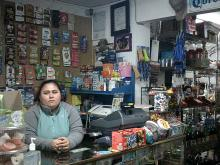 Woman standing behind convenience store register