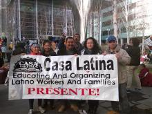 Demonstrators with sign