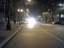 street at night with headlights in distance