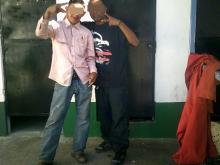 two men posing for camera
